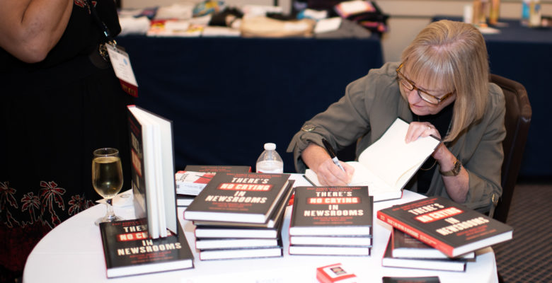 Woman signing books